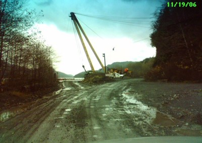 3rd Loaders were expected to climb on top of loaded logging trucks and stamp the ends of the logs.